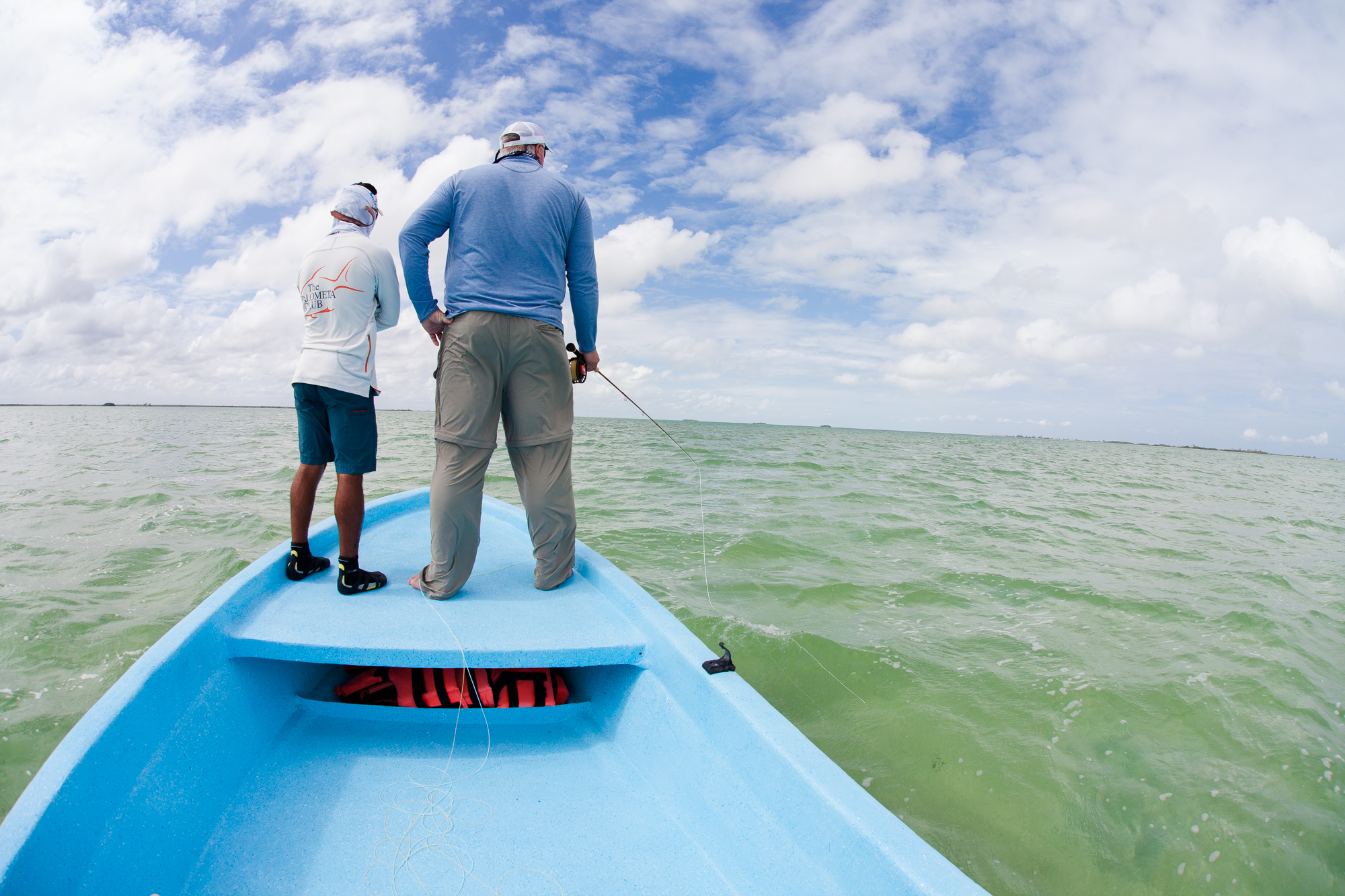 Chris Hunt and guide Julio scan the flats for feeding permit. (photo: Chad Shmukler)