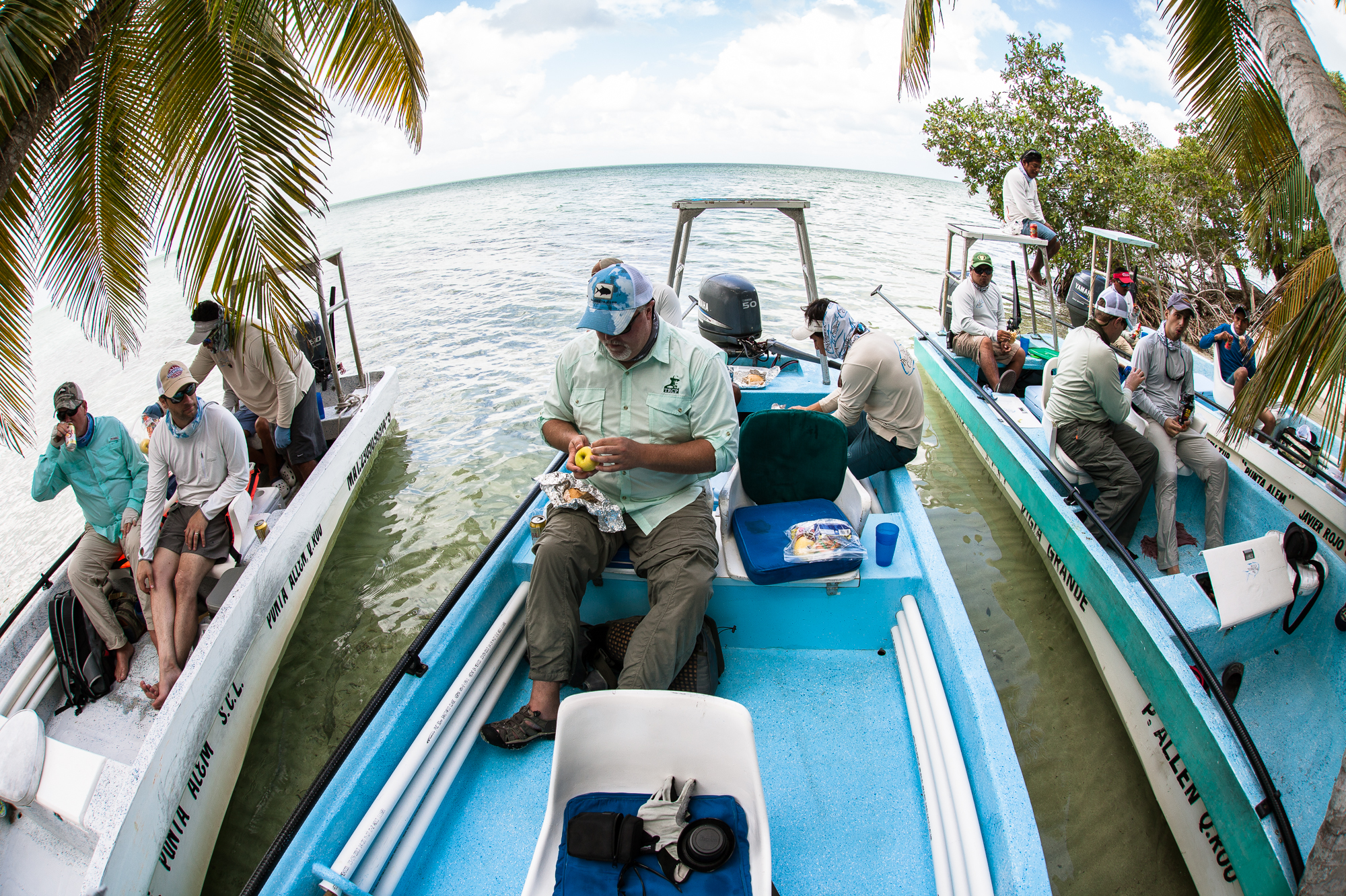 (2/4) An idyllic island serves as a meeting point for a midday lunch where tales of the morning's happenings are shared. Resident iguanas quickly emerge from the jungle brush in search of handouts from anglers (photo: Chad Shmukler).
