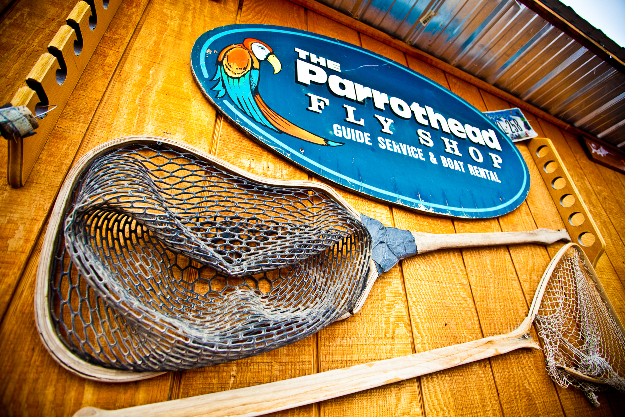 Living on island time. Headhunters Fly Shop's bright turquoise- and orange-painted walls are accented by tropical signs, making it stand out from other Western fly shops.
