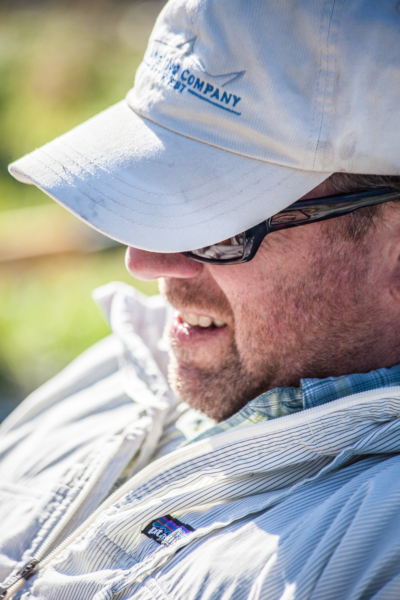 John Arnold, co-owner of Headhunters, enjoys a day in the boat and the glow of a summer sun.