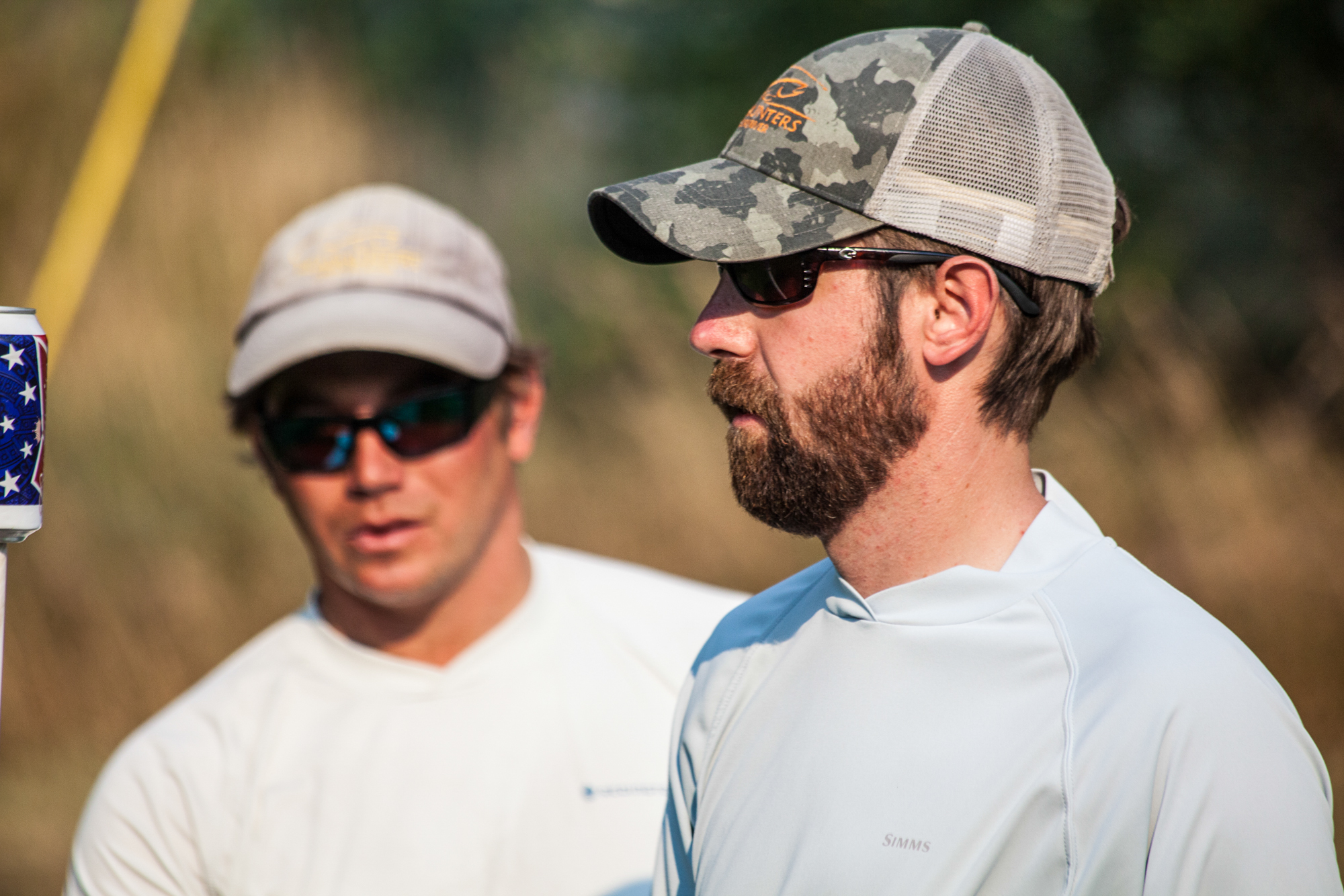 Headhunters fly guru Ben McNinch (right) and guide Nick Stippich work the team angle during a cutthroat game of Polish Horseshoes after the Caddy Day float. On or off the river, fishing style rules.