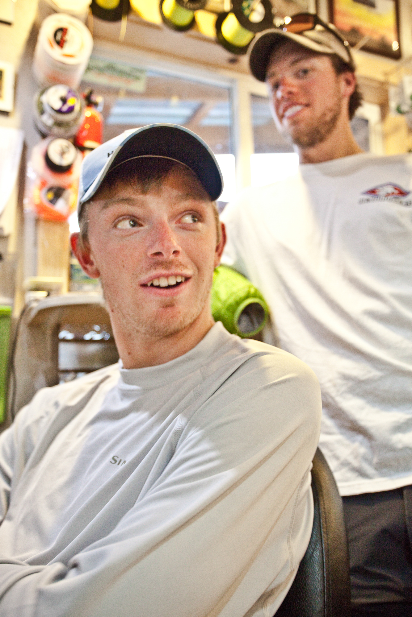 Long shops nights. When the guides are in and the rental boats still out, it's time to clean and restock. When the work is done, fly-fishing video watching begins. Jake Gates and Travis Whitfield enjoy a rare moment of down time.