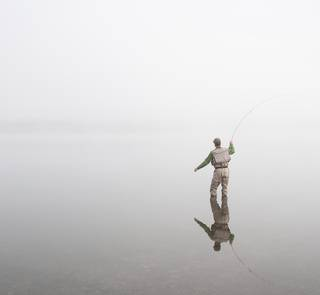 fly fishing - foggy day - Hebgen Lake, MT