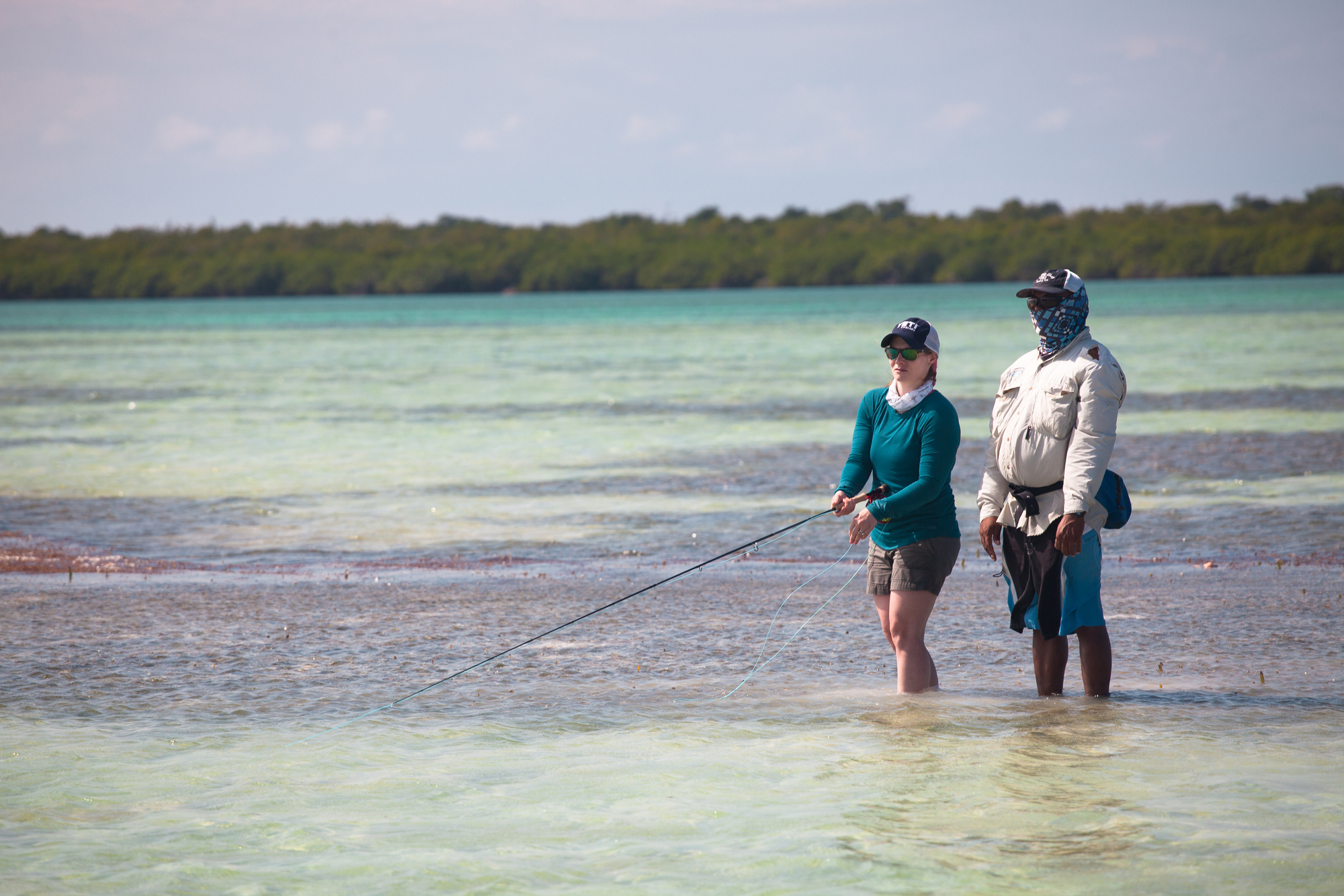 It's not long before it dawns on me that this is an easy sell. Casting lessons in the grass outside the fly shop don't hold a candle to class held on the Turneffe Atoll's sun drenched flats.