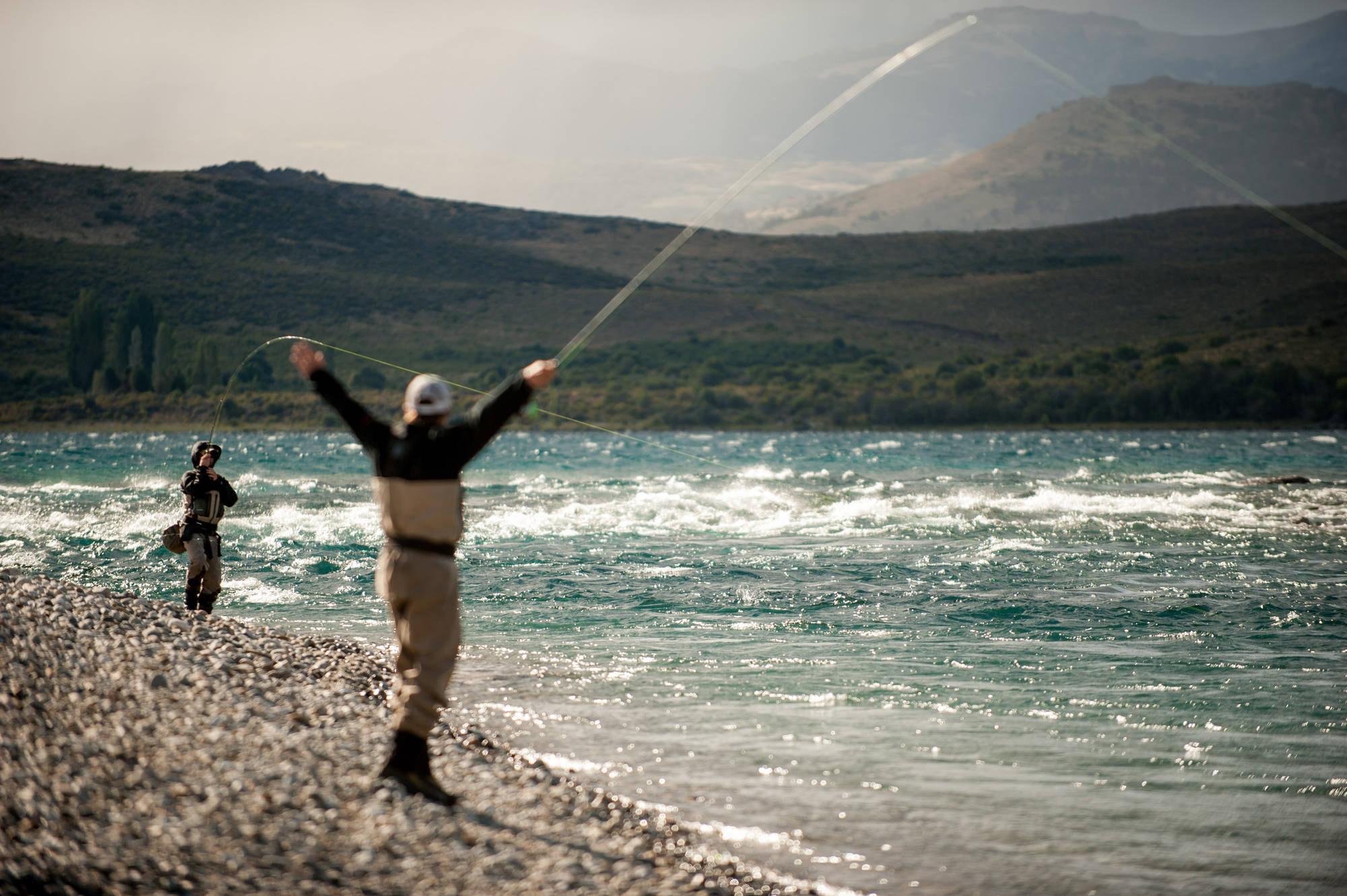 "When photography isn't about capturing scale or colors, it is about capturing the moment. Here, on the brawling Limay River near Bariloche, Argentina, Santos Fernandez Madero hooks into what turned out to be ""just a 25-inch brown trout."" Photo: Alex Knull."