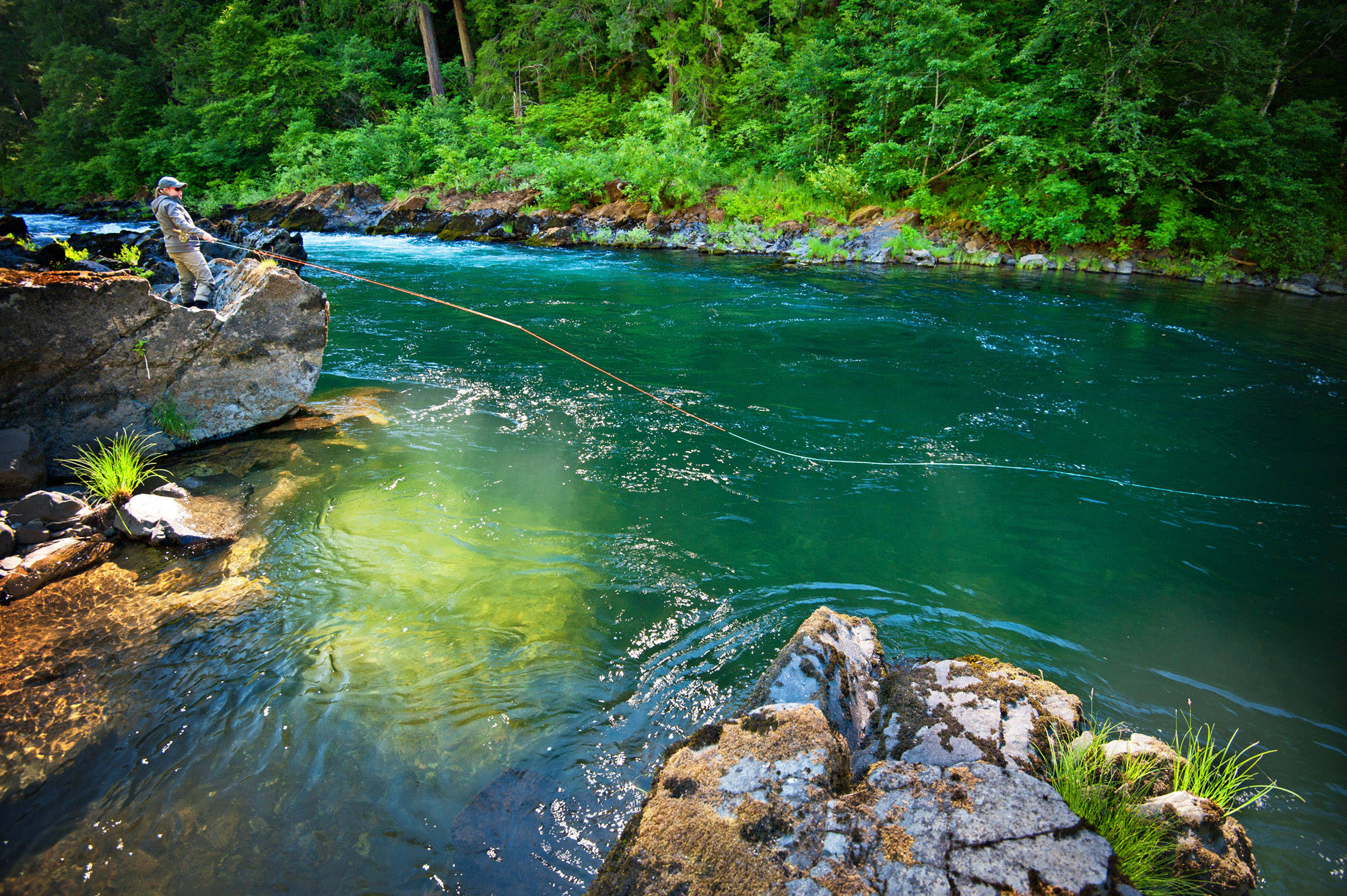 Saturation slider much? Nah, not on this one. If you've been lucky enough to find yourself on the banks of Oregon's North Umpqua River, you know the colors in this image are all too real. Photo: Arian Stevens. Angler: Jesse Ball.