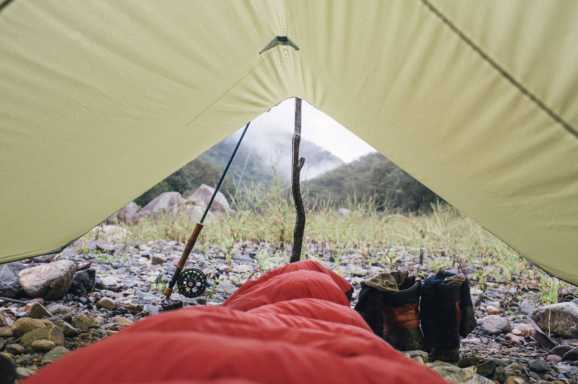 Jono Winnel has an eye for what makes a good photo, a fact that is well illustrated here. Like the simplicity of sleeping under a tarp, this shot is unpretentious, doesn't feel overwrought and yet manages to capture the essence of a day in the backcountry about to begin.