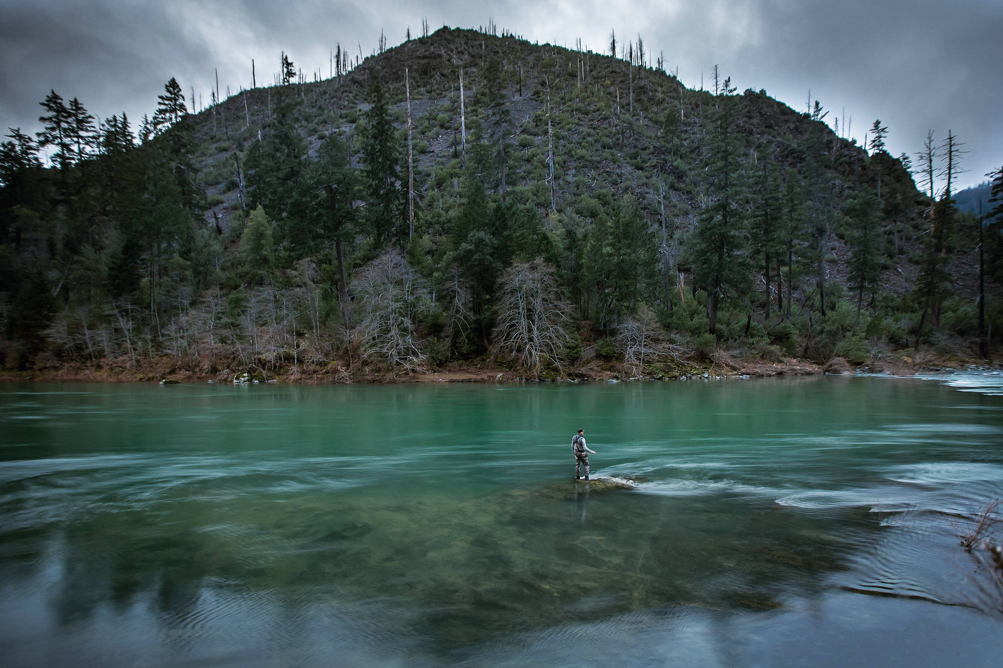 Swinging flies for winter steelhead is a dark, contemplative business only to be undertaken by the most serious anglers with deep, deep thoughts. Don't believe me? Just look. Photo: T.J. Orton.