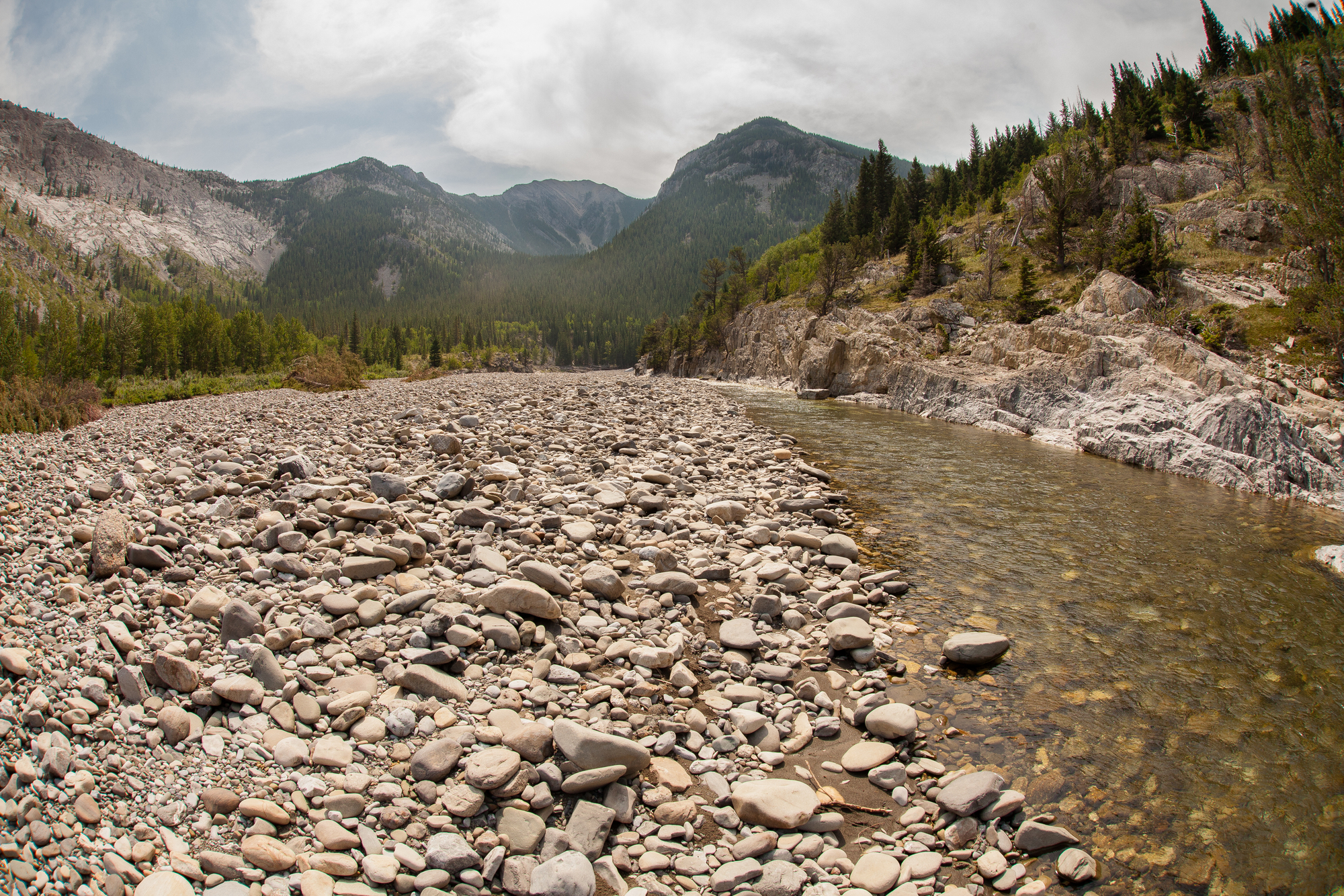 (2/3) The group scouts a river in nearby Alberta, also an easy drive from downtown Fernie.