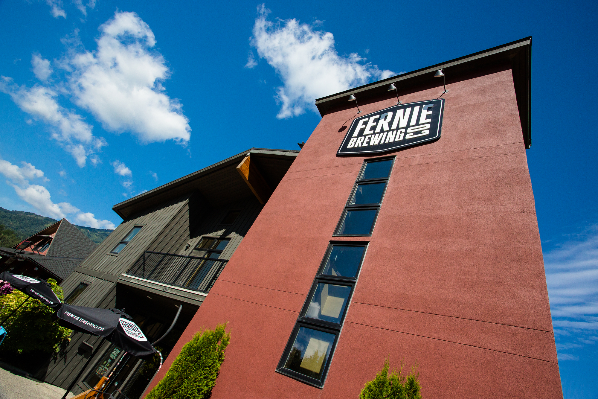 (1/2) Strategically placed just outside town on the main, the Fernie brewing company welcomes anglers returning from a day on the Elk upstream of town.