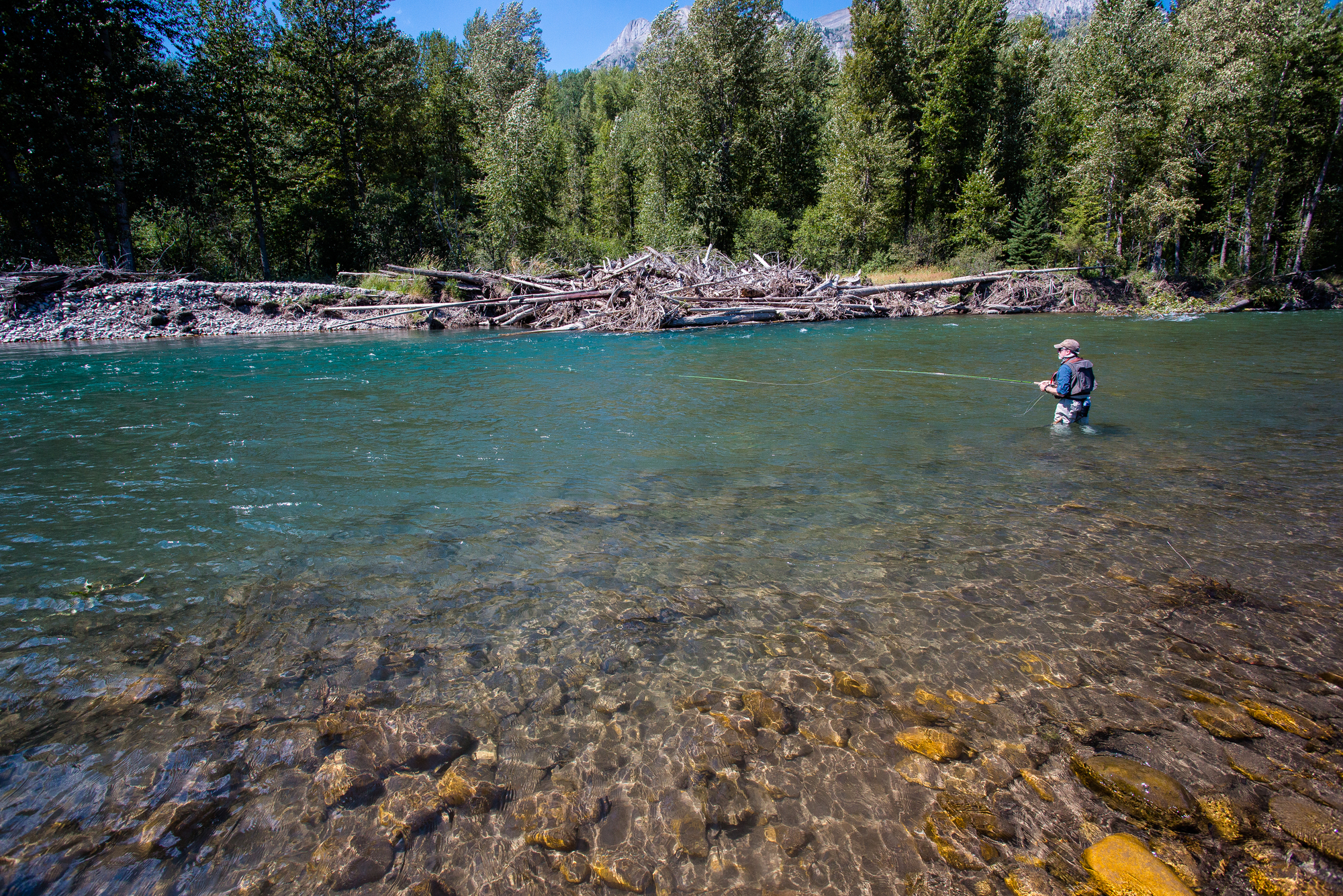 Mike Sepelak swings streamers through a deep run on the Elk River in hopes of bull trout.