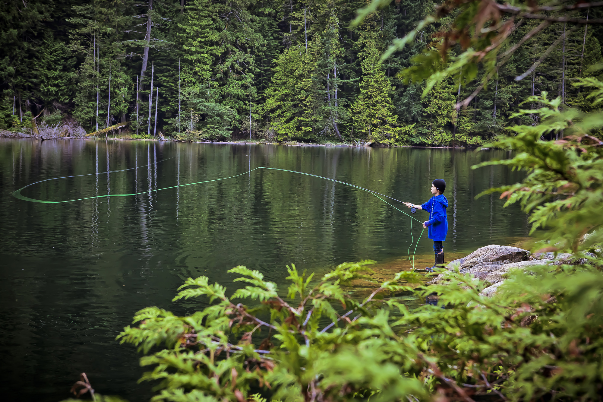 "(RUNNER UP)  While those of us who love fly fishing hope we'll be able to instill a love of the sport in our children that will send them to seek water, sometimes the motivation comes from an altogether unexpected source. 10 year old Finn, pictured here, broke his arm leaving him unable to ""ride bikes for the summer."" Instead he took up fly fishing, and is said to be hooked for life."
