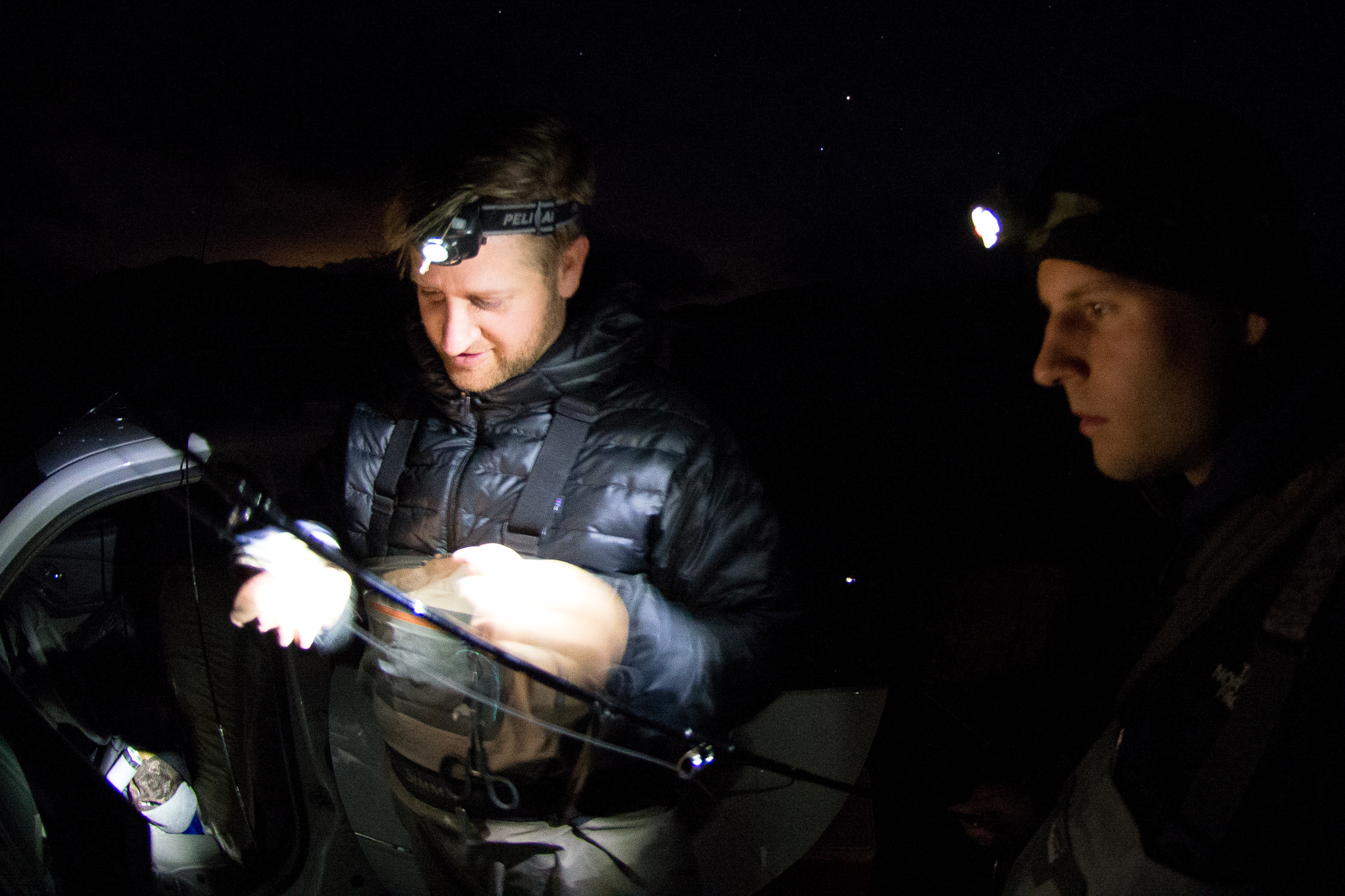 Weston Gleave helps with a few additional lumens as Kyle Graf attempts to pick out a winning leader in the dark.