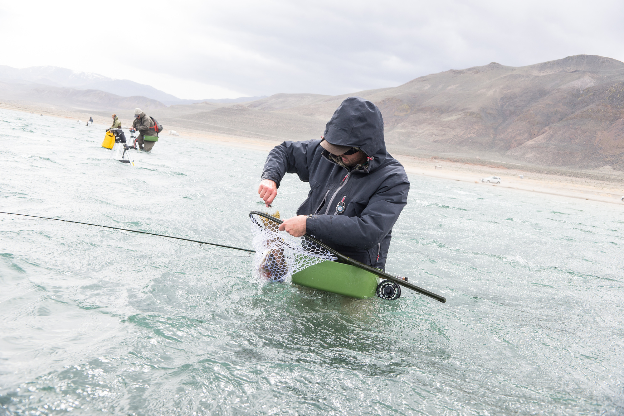 (1/2) Ben Smith, having moved beyond expert level, decided to practice the master level art of catching fish without a rod or flies. Either that, or he dropped his cutthroat before the camera was ready, and decided to try one last grab.