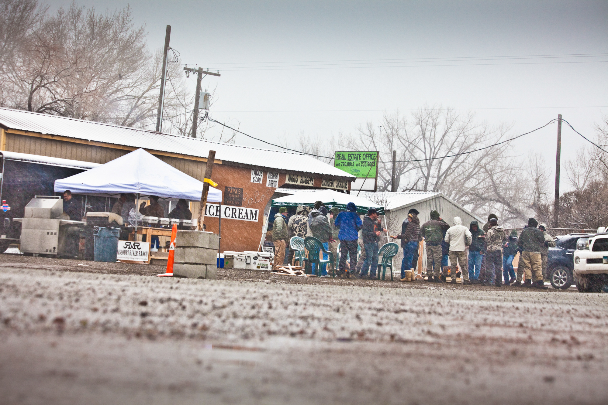 If April showers bring May flowers, then maybe April blizzards bring May hatches? Sometimes cabin fever wins and, when spring is late in coming, the show must go on. Guides, anglers, and industry folk mingle at an Orvis-hosted event in late April in downtown Craig, Montana.