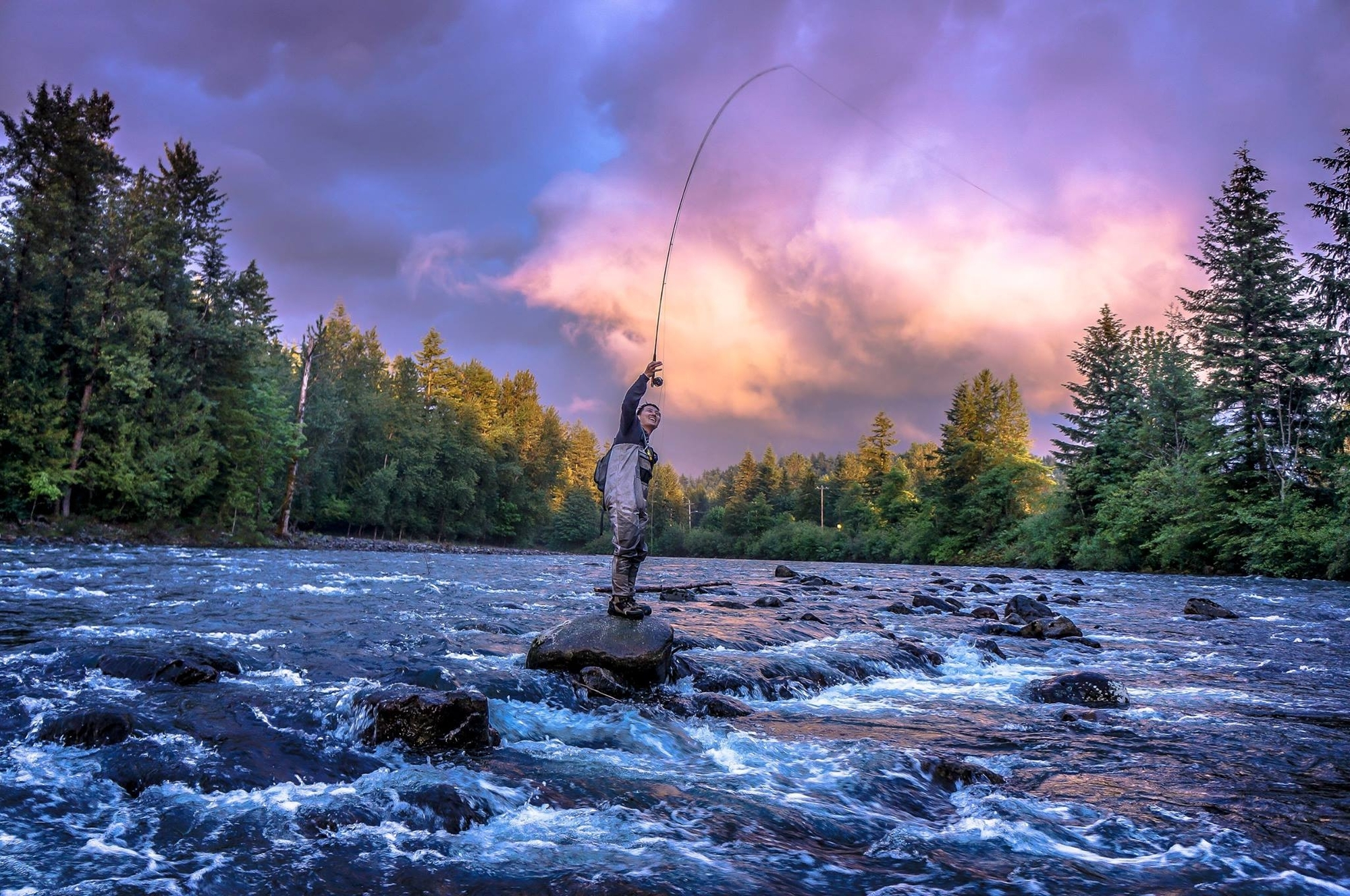 This image, captured by Joey Mara, shows angler Josh Lo hooked up to a native cutthroat during golden hour on the Snoqualmie River, shortly after taking a dip in the drink.