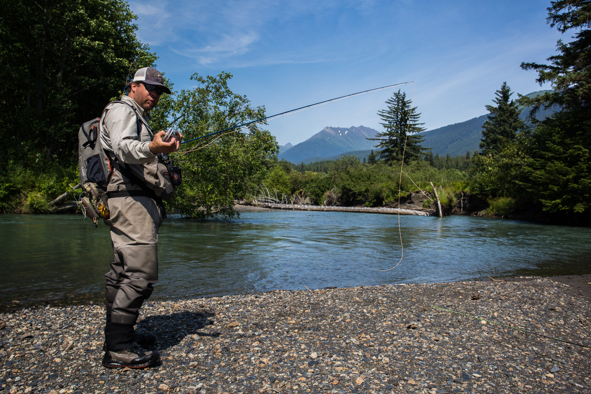 Temperatures having soared into the eighties and the mid-afternoon sun beats down through uncharacteristic bluebird skies. With the number of pink salmon brought to hand long into the hundreds, it is easy to take a seat, despite the otherworldly fish catching opportunities that lay just feet away. Still, guide Mark Heironymous, the only one present that has regular access to the bounty of the Tongass, rebuilds his rig to chase a few fat pinks that are sunning themselves in a back eddy not far below.