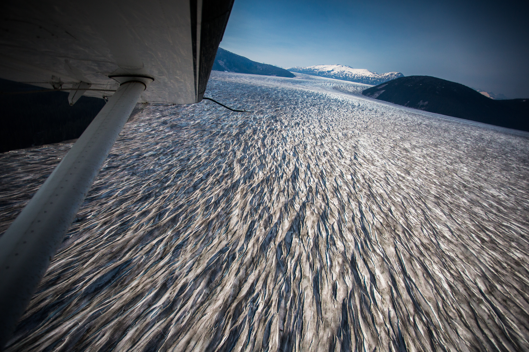 The Taku Glacier, one of the seemingly countless glaciers that surround Juneua, is seen here from the air. The Taku glacier is a tidewater glacier known to be the thickest glacier in the world at nearly 5,000 feet thick (photo: Chad Shmukler).