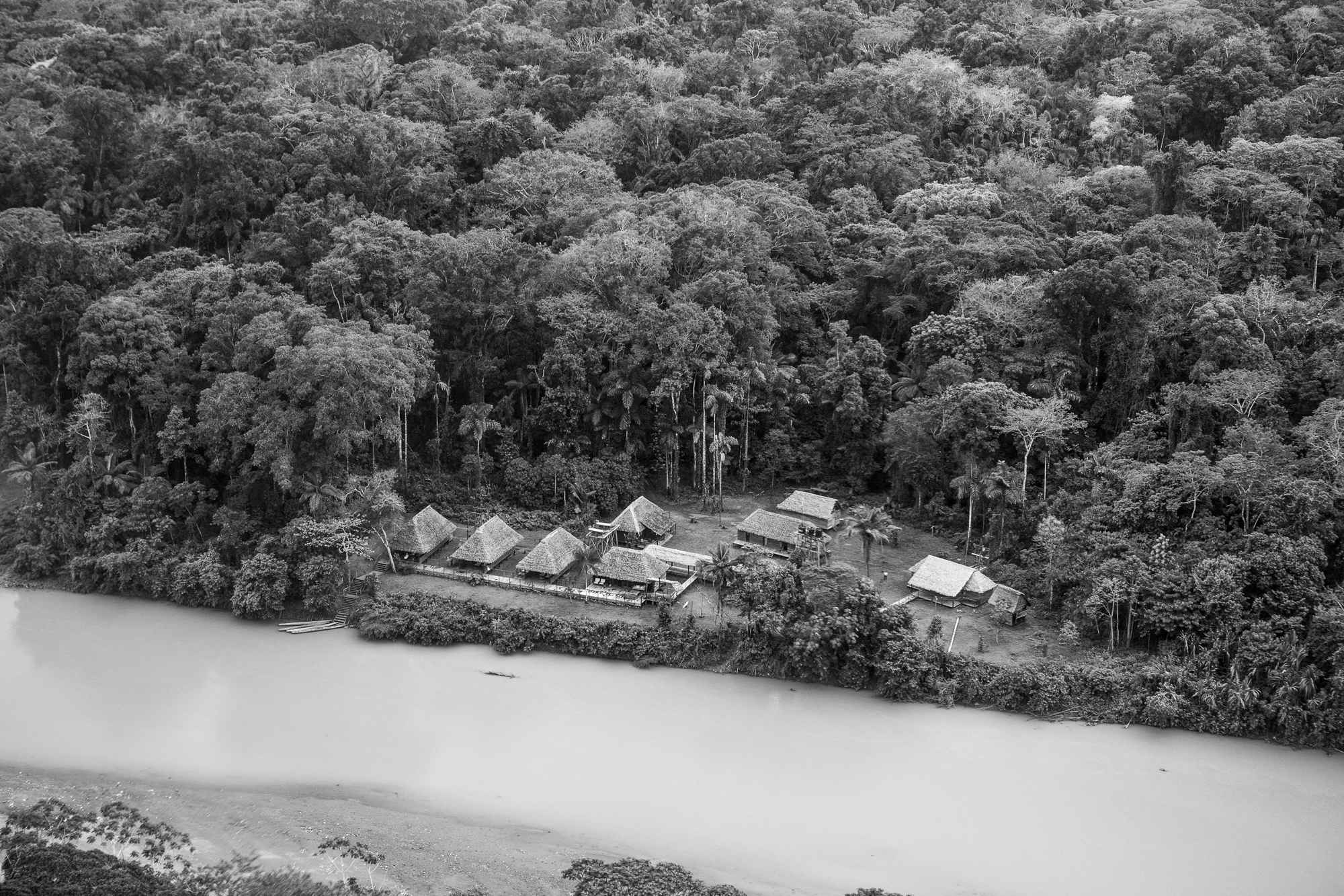 Aerial view of Pluma Lodge. The river here is quite high and muddy due to a huge storm system that had recently passed through.