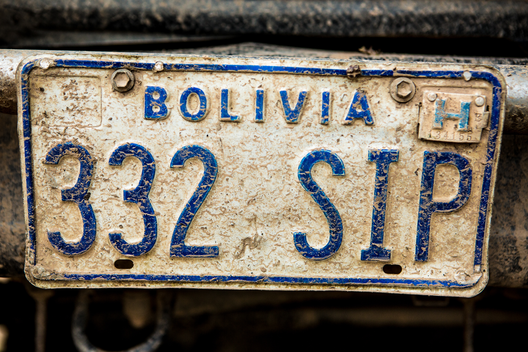 A beat up Bolivian license plate.