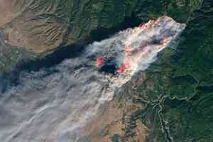 camp fire from space