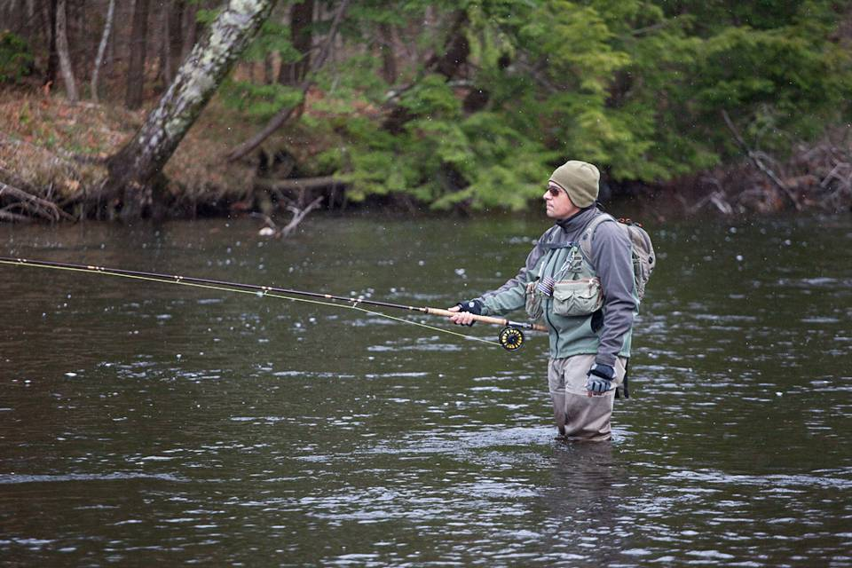 Snow falls as George Costa swings through Paradise on NY's Salmon River.