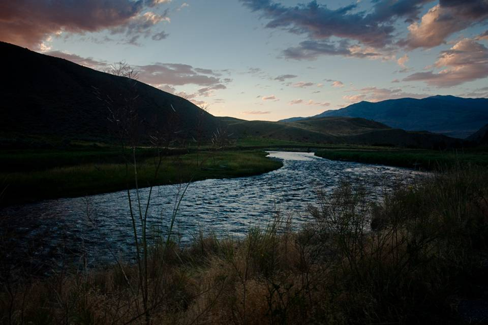 The sun sets on the Gardiner River in Yellowstone National Park.