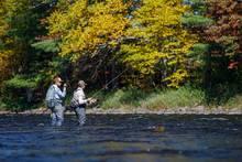 angler helping angler   fly fishing