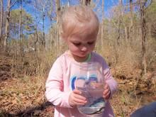 child holding mason jar aquarium
