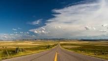 montana farm road blue skies