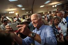 Joe Biden poses for a photo-op with campaign supporters