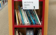 fly fishing books on shelf