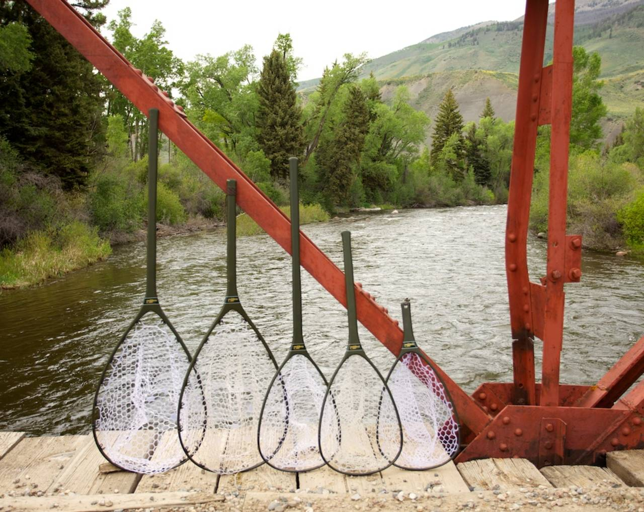 Fishpond acquires nomad nets hatch magazine fly for Fishing landing net