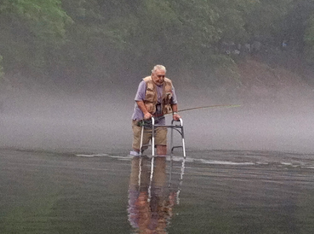 "(HONORABLE MENTION) Kendra Nelson, who captured this image, noted that she was ""inspired by this man's determination to do what he loves, despite the obvious restrictions his body has tried to place on his love for fishing and the outdoors."" And she's not alone. This truly impactful image has been seen by almost 300,000 people on Facebook and has been widely shared on Twitter, Reddit and so on. While this image lacks the technical quality of the others, it more than makes up for it with substance."